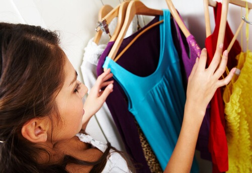 girl sorting through clothes