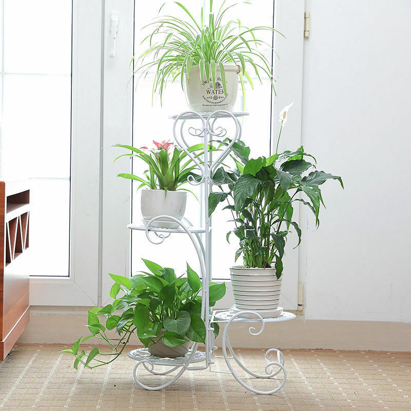white metal tiered plant stand