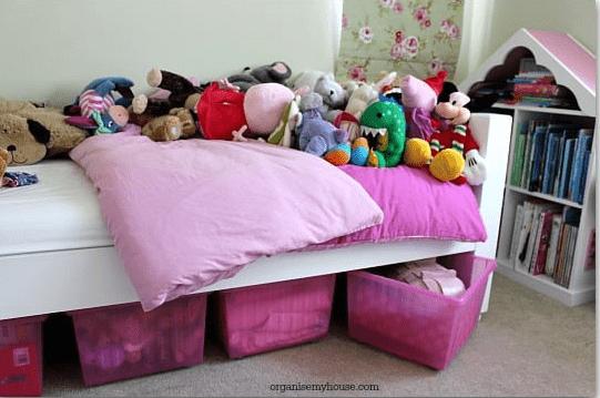 pink storage tubs under bed