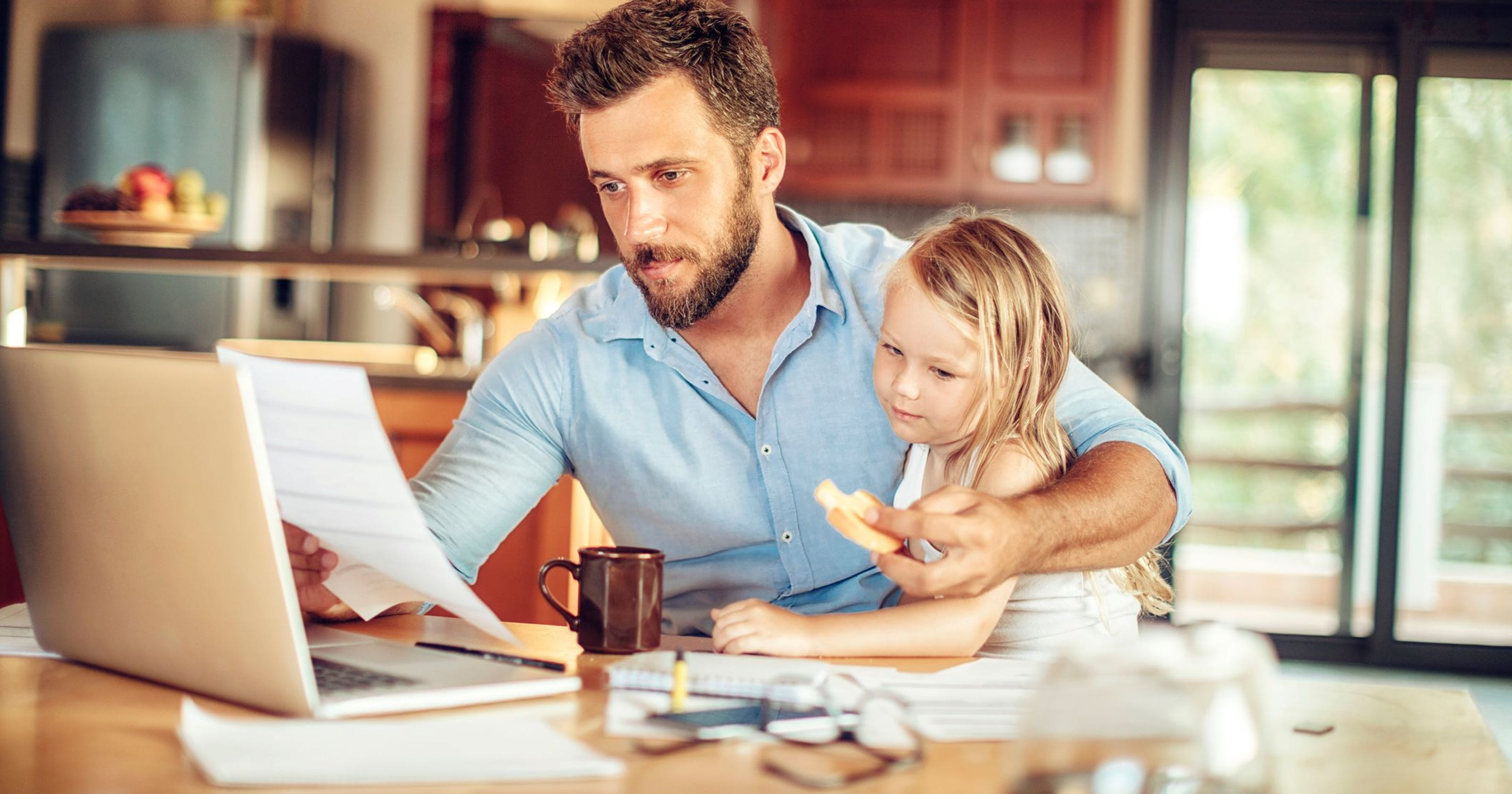 Man working from home wit daughter