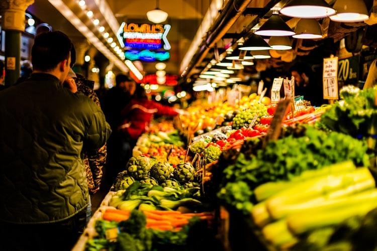A man looking at fruit at a market