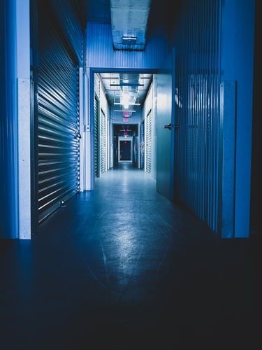 A darkened storage facility hallway