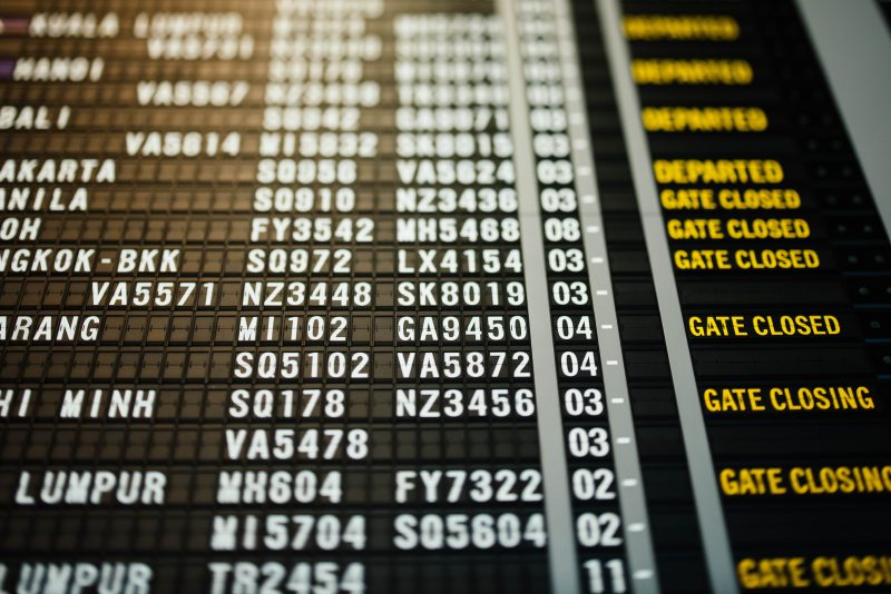 list of flights on a black board