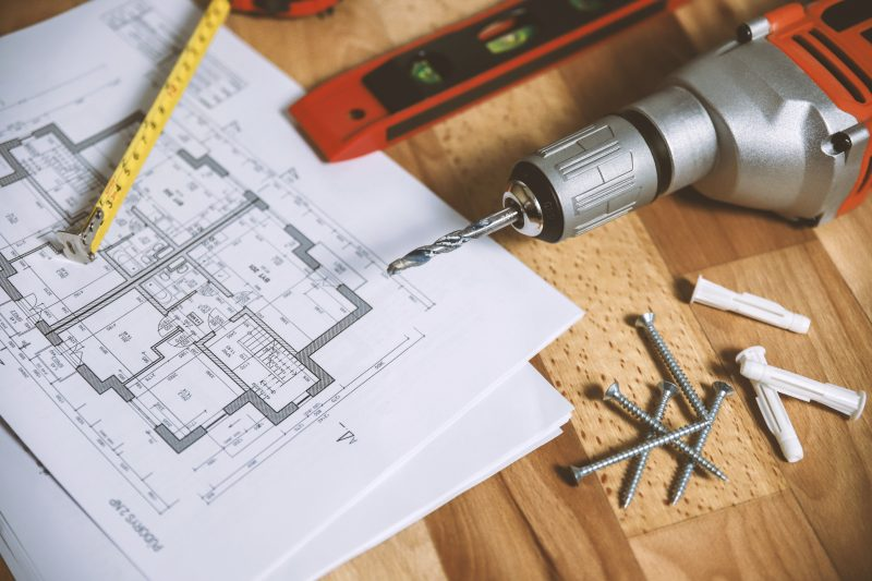 floor plan and tools on table