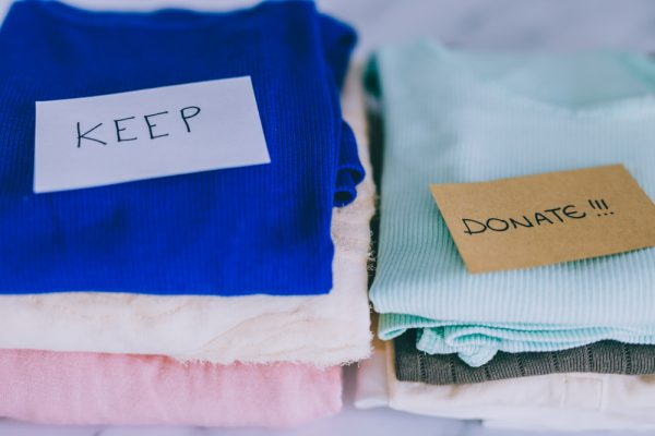 clothes being segregated for donation and keeping during decluttering