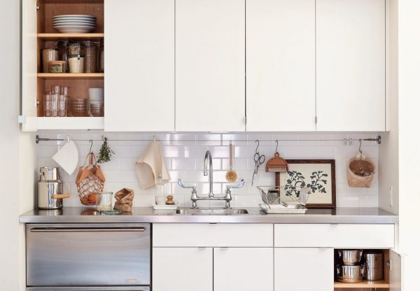 an organized kitchen cabinet and countertop