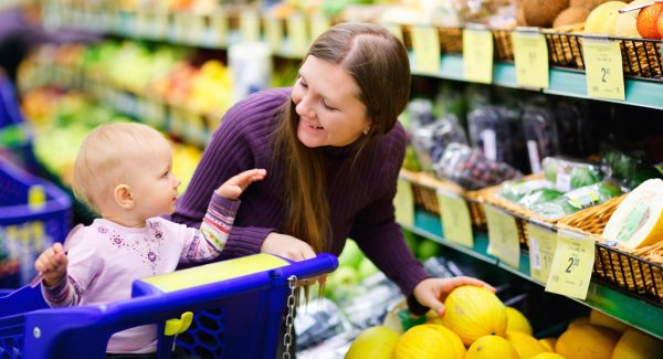 a mother and her baby shopping for groceries
