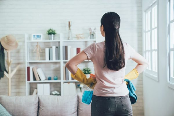 a woman getting ready to declutter and clean her living space