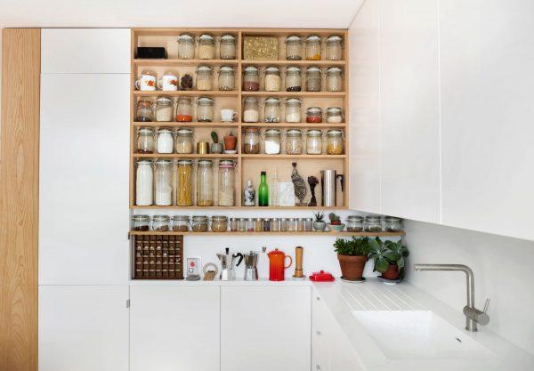 an organized kitchen with a wide shelf