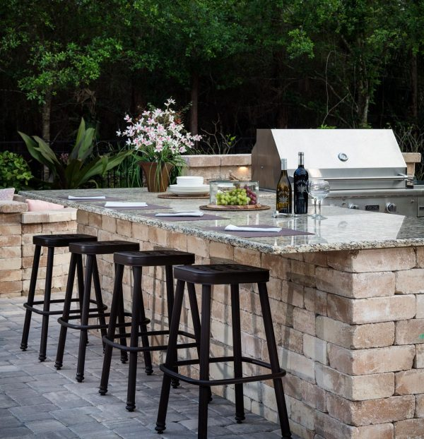a modern outdoor kitchen with a granite counter top