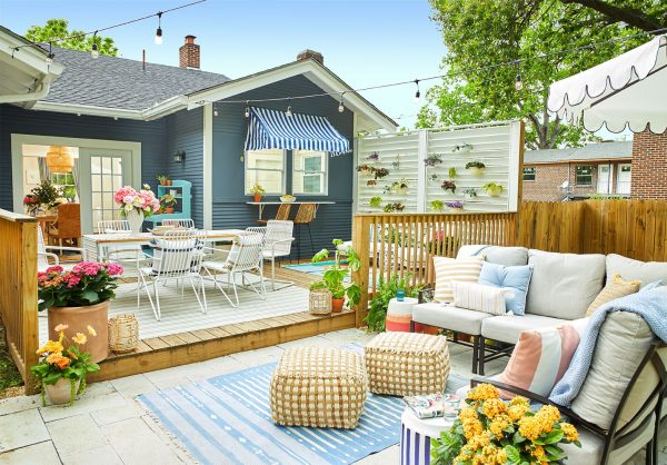 a cosy outdoor entertainment area with colorful pillows
