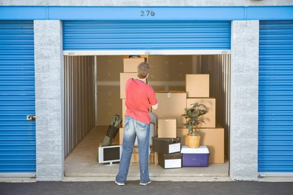 a man shutting down the door of his self storage unit