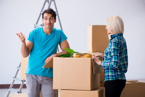 young family moving in to new apartment