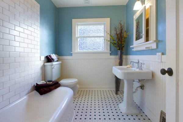 a modern clean bathroom with a small bath tub