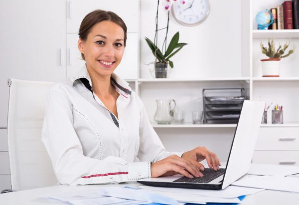 a businesswoman using her laptop to work
