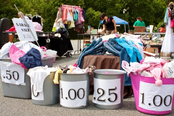 A garage sale of baby clothes