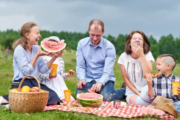 A family eating and having a picnic togther