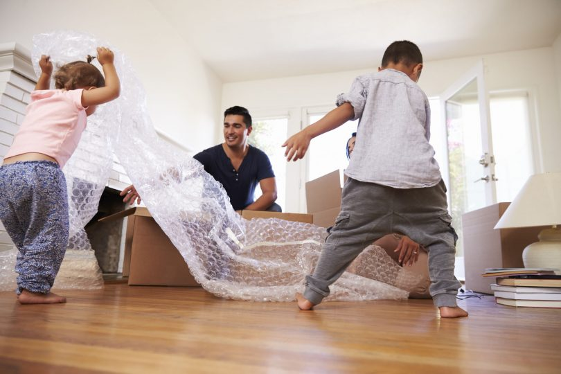 family unpacking surrounded by bubblewrap