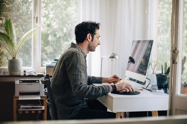A man working from home on his desk