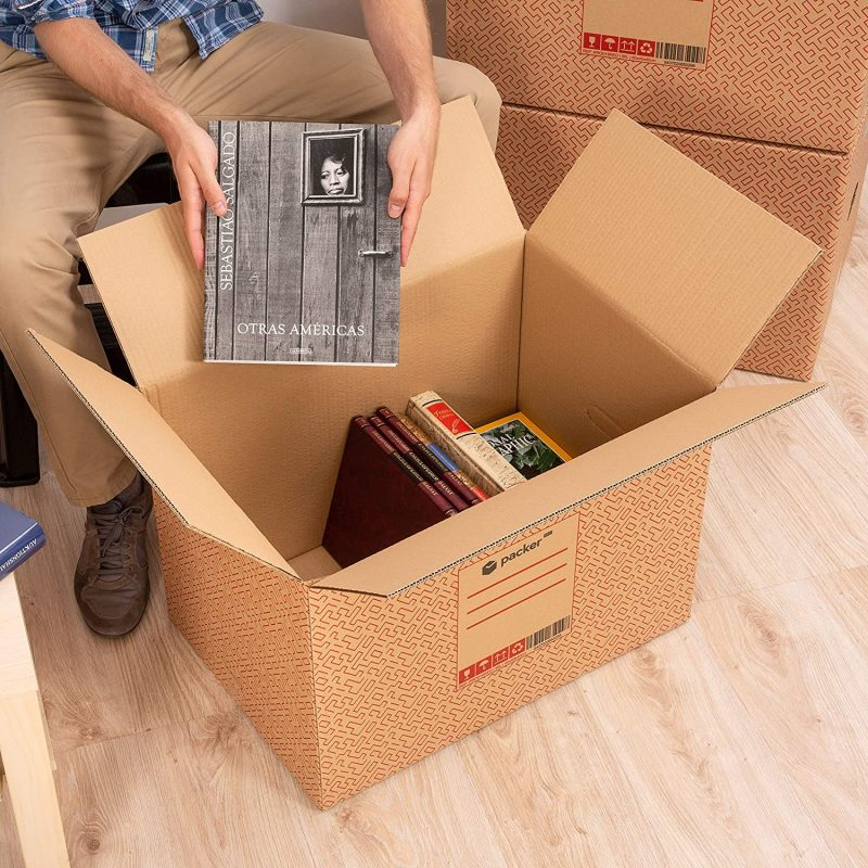 A man packing photo albums